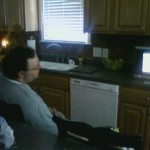 Chris and Madilyn watching Toy Story in the kitchen.