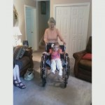 Mammaw pushing Madilyn in her wheelchair
